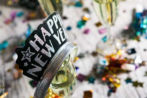 Fotografie, Obraz  Happy New Year Crown Sits Upon Glass Of Champagne