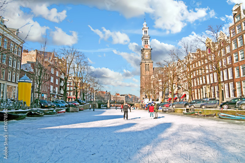 Amsterdam in winter with the Westerkerk in the Netherlands Canvas-taulu