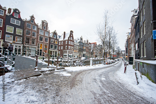 Foto op Canvas Drawn Street cafe Snowy Amsterdam in the Netherlands in winter