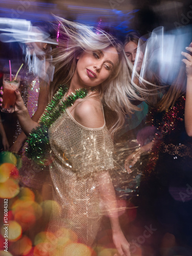 Vászonkép Female in night club in blurred motion