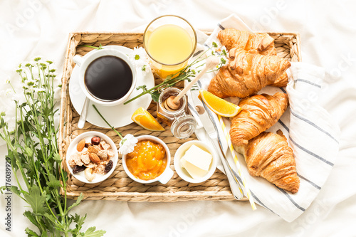 Continental breakfast on white bed sheets - flat lay Canvas Print