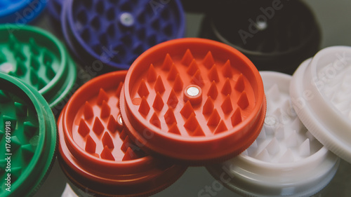 Photo  color grinders for weed buds buds close-up. .