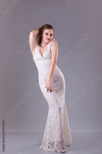 Curvy model with long hair, red lips wearing evening white ...