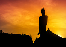 Silhouette Big Buddha Statue Standing In Thai Temple Roiet, Thailand On Sunset Time