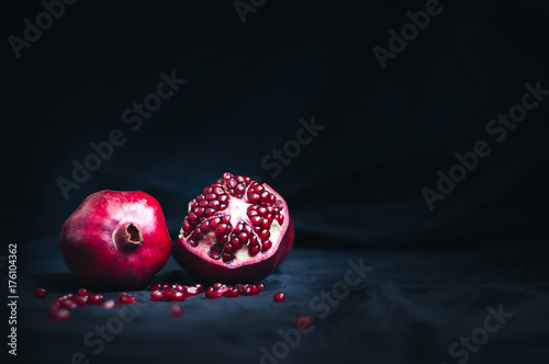 fresh pomegranate on a black background