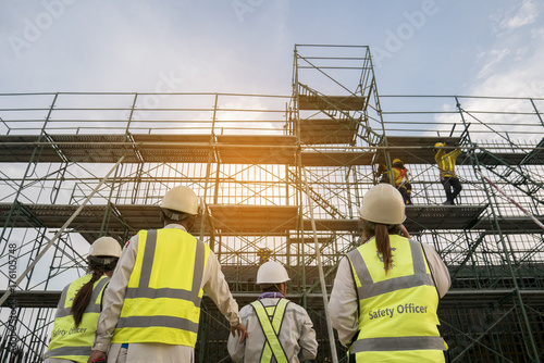 Fotografie, Obraz Civil engineer and safety officer in spec steel truss structure scaffolding risk