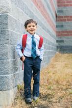 Happy Boy In School Uniform La...