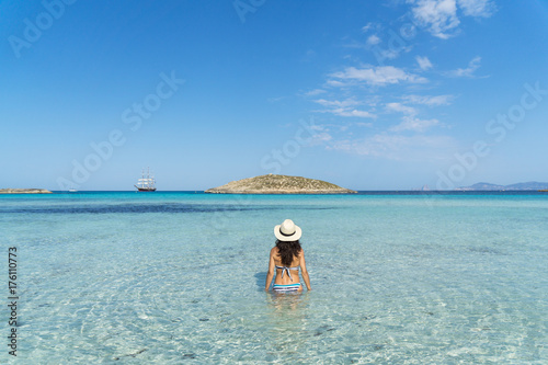 Young woman in a paradise beach