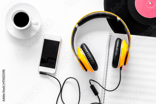 Fototapeta Accessories of contemporary composer. Headphones. phone, vinyl record, music notes on white background top view obraz na płótnie