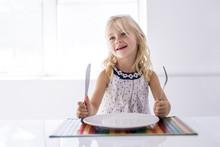 Little Girl Holding Fork Empty...