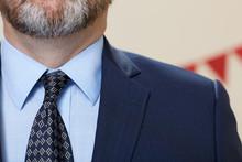 Bearded Man Wearing Suit With Necktie
