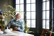 Senior Man Using Digital Table...