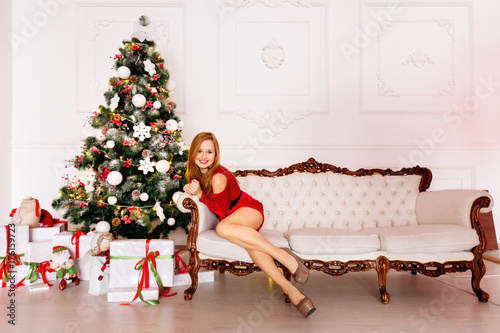 charming pretty girl enjoying christmas and sitting in the room - What To Buy A Girl For Christmas