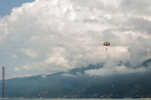 Foto op Canvas Luchtsport Parachute among the clouds
