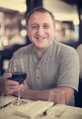 Happy charming man at restaurant