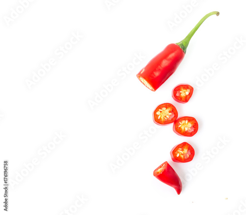 Foto auf Leinwand Hot Chili Peppers Closeup top view red chili pepper with sliced on white background, raw food ingredient concept