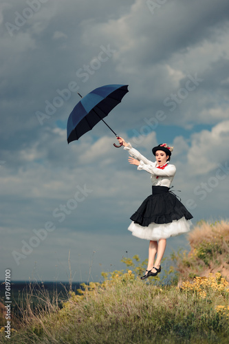 Obraz na plátně  Retro Woman with Umbrella Up in The Air in Fantasy Portrait