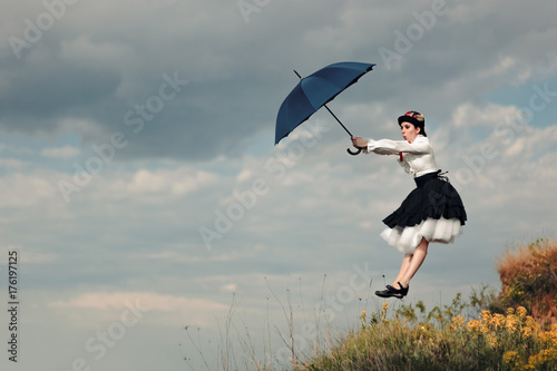Valokuva  Retro Woman with Umbrella Up in The Air in Fantasy Portrait