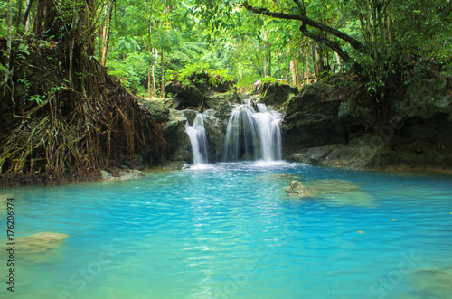 Foto op Canvas Watervallen Blue lake and small waterfall. Bright exotic nature with fresh water stream.
