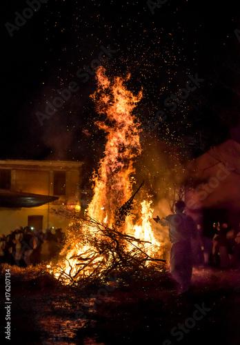 People celebrate St John's Eve around a bonfire in a greek village Wallpaper Mural