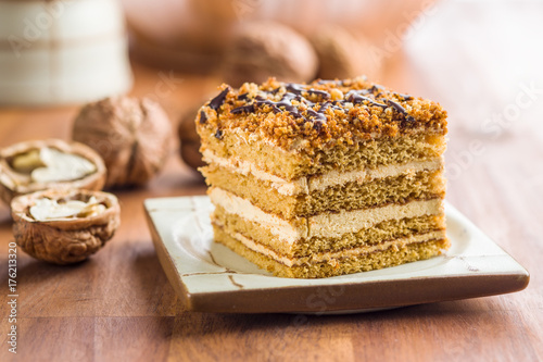 Spoed Foto op Canvas Dessert Cake with walnuts and honey.