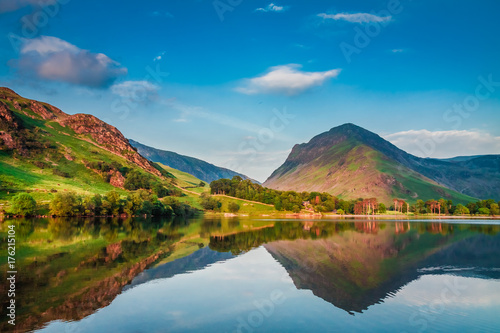 Fototapeta Beautiful sunset at lake in District Lake in UK