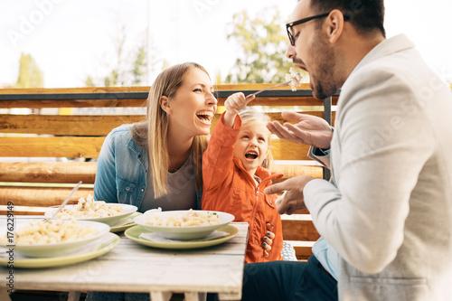 Fotobehang Restaurant Family enjoying pasta