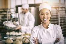 Happy Female Baker Smiling At ...