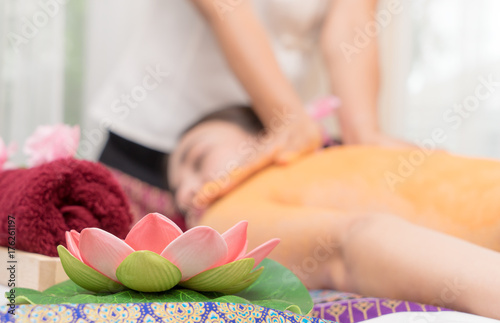 Lotus flower with Women taking Spa scrub on the background