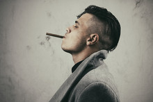 Young Man In Grey Coat Smoking...