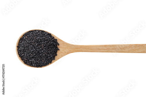 Black sesame on wood spoon isolated on white background