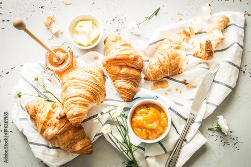 Croissants, jam, honey and butter - continental breakfast Wallpaper Mural