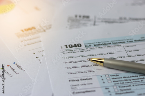 Selective Focus A Pen On Us Tax Form 1040 On Top For Background