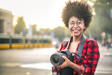 Cheerful Girl Walking Around The City With A Camera