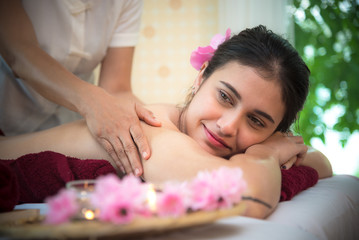 Obraz na płótnie Canvas Masseur doing massage spa with treatment on Asian woman body in the Thai spa lifestyle, so relax and luxury. Healthy Concept