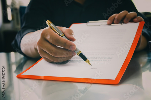 Close up of business man signing contract making a deal, business contract details Canvas Print