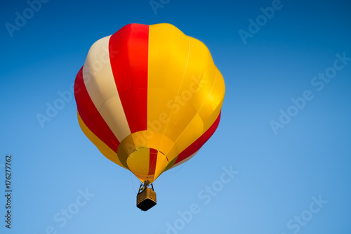 Deurstickers Luchtsport Colorful of Hot air balloon with fire and blue sky background