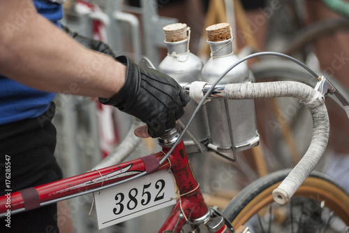 Fotobehang Fiets Vintage bicycle with aluminum canteen on the handlebar