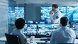 In the Security Control Room Chief Surveillance Officer Holds a Briefing for Two of His Subordinates. Multiple Screens Show that They Guard Object of Big Importance.