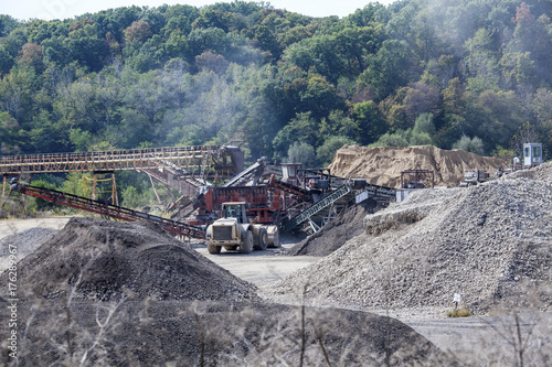 Photo Gravel pit with conveyors and heavy equipment