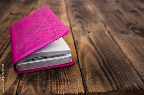 pink bible wooden background