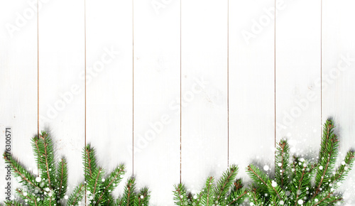 christmas snow covered branches on a white wooden background new years background holiday