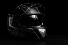 A Black Motorcycle Helmet On D...