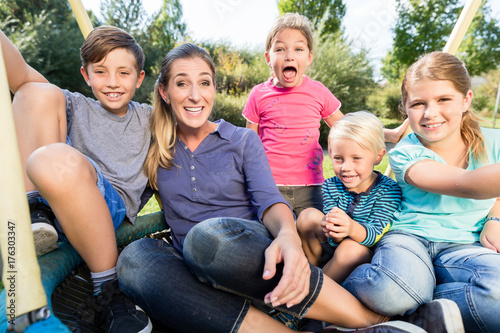 Fotografie, Obraz  Family with mom, sons and daughters taking photo together outdoors