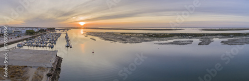 Fotografía Sunrise aerial seascape view of Olhao Marina, waterfront to Ria Formosa natural park
