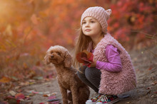 Little Girl Sitting With Dog T...
