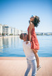 Happy couple. Fashion man and woman. Love story. Sea background. Vacation, travel, tourism. Love game.