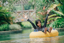 Young Woman Enjoying Tubing At...