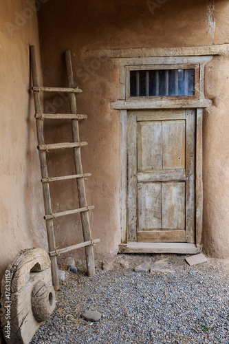 Fotografie, Obraz  Roughly made door and ladder in an historic adobe hacienda