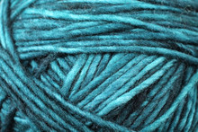 A Super Close Up Image Of Blue And Green Yarn